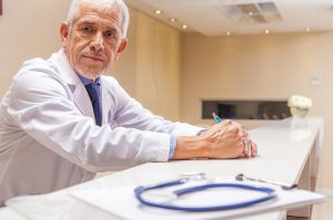 Doctor Looking Worried as He Considers the Horrific Medical Malpractice Errors He's Committed